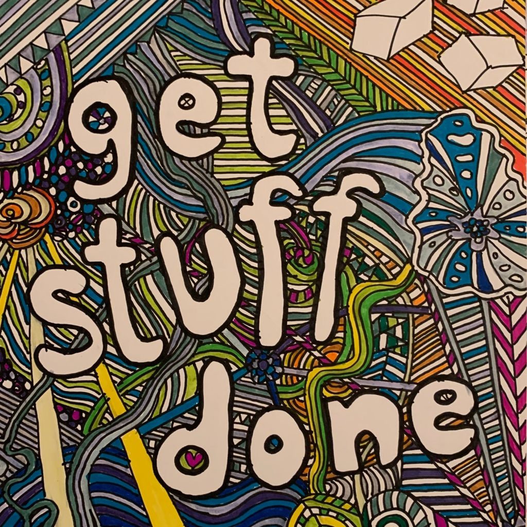 """Photograph of the words """"get stuff done"""" on a hand drawn zentangle-esque background coloured in various deep shades of felt tip pen.  © rainiestinertias.com"""